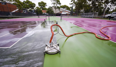 A tennis court high pressure cleaning