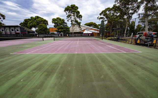 School tennis court before pressure cleaning