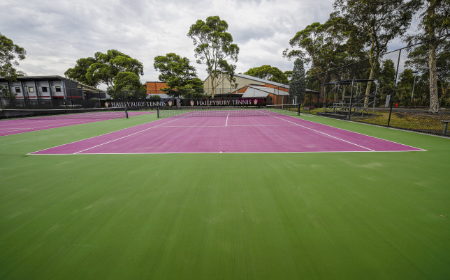 School tennis court after pressure cleaned